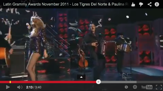 Los Tigres Del Norte perform with Paulina Rubio at the 2011 Latin Grammy Awards.